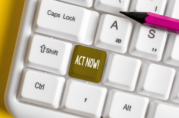 Writing note showing Act Now. Business concept for do not hesitate and start working or doing stuff right away White pc keyboard with note paper above the white background