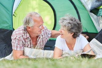 Happy couple seniors camping