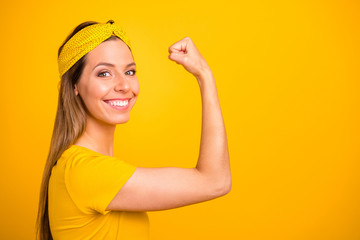Closeup photo of beautiful lady showing perfect hand muscle wear casual t-shirt isolated yellow background