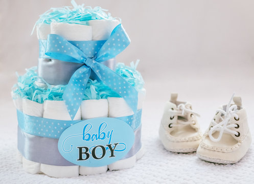 Present cake with diapers for newborn baby boy