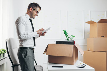 Businessman moving into a new office
