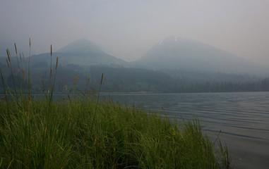 Smoke shrouds Summit Lake with a thick blanket of smoke from the Swan Lake Fire on Kenai Peninsula
