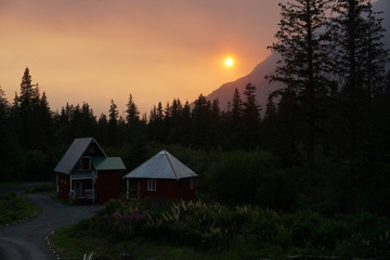 Smoke creates a red hazy sunset from the Swan Lake Fire on the Kenai Peninsula, in Seward, Alaska