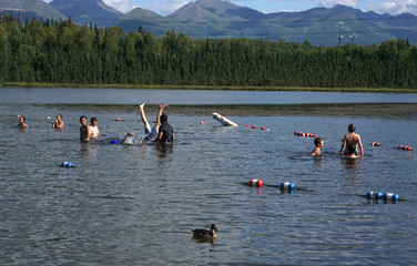 Swimmers cool off at Goose Lake in Anchorage