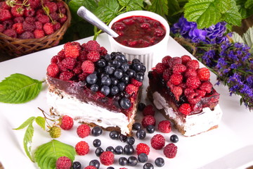 Cake with cream and fresh raspberries and blueberries useful delicacy