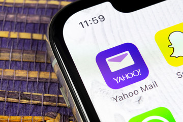 Sankt-Petersburg, Russia, December 5, 2018: Yahoo Mail application icon on Apple iPhone X smartphone screen close-up. Yahoo mail app icon. Social network. Social media icon