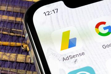 Sankt-Petersburg, Russia, December 5, 2018: Google AdSense application icon on Apple iPhone X screen close-up. Google AdSense app icon. Google AdSense application. Social media network