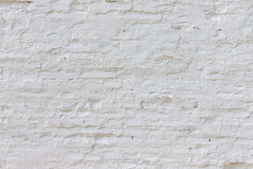Old white whitewashed brick wall