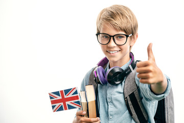 Smiling english schoolboy shows thumbs up