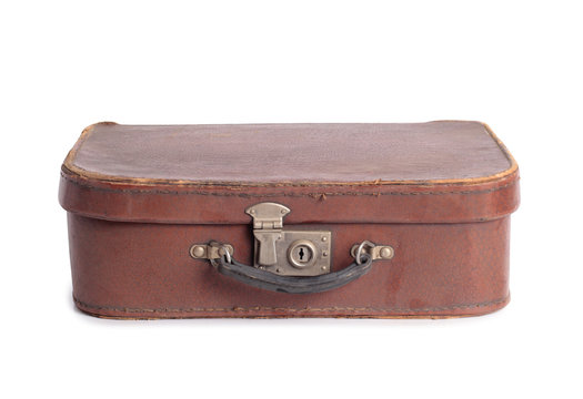 Old leather suitcase on a white background