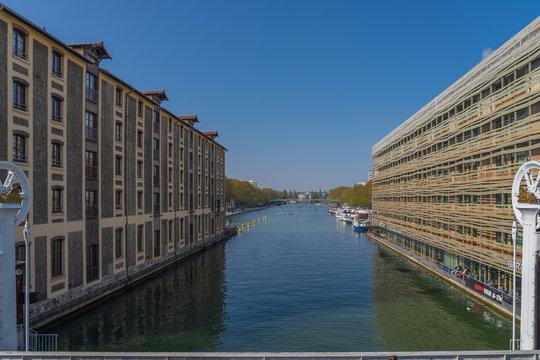 Paris, France - 04 14 2019: Canal Lourcq. Bridge of Flanders