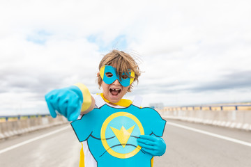 Wall Mural - young boy smiling in super hero suit