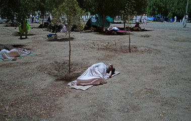 A pilgrim sleeps as after he arrives in Arafat to mark haj's most important day, Day of Arafat, during his Haj pilgrimage in the holy city of Mecca