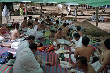 Pilgrims eat as they begin gathering in Arafat to mark haj's most important day, Day of Arafat, during their Haj pilgrimage in the holy city of Mecca
