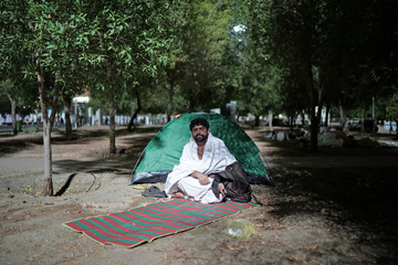 A pilgrim rests as he arrives in Arafat to mark haj's most important day, Day of Arafat, during his Haj pilgrimage in the holy city of Mecca