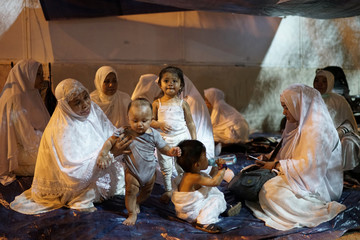 Pilgrims rest as they begin gathering in Arafat to mark haj's most important day, Day of Arafat, during their Haj pilgrimage in the holy city of Mecca