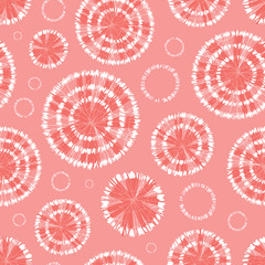 Vector coral pink shibori circle wheels abstract seamless pattern with. Suitable for textile, gift wrap and wallpaper.