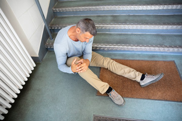 Obraz Mature Man Sitting On Staircase - fototapety do salonu
