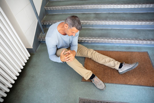Mature Man Sitting On Staircase