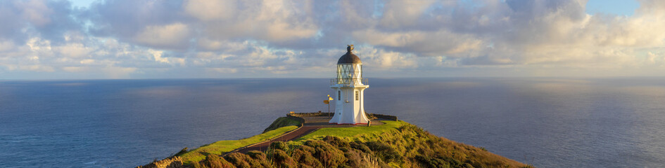 Spoed Foto op Canvas Beige Cape Reinga lighthouse panorama, Pacific ocean, New Zealand