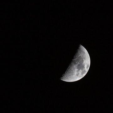 Beautiful shot of a half-moon in the dark sky
