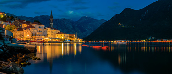 Sunset panoramic view of Kotor Bay and the lights in the postcard perfect town of Perast, Montenegro, long exposure