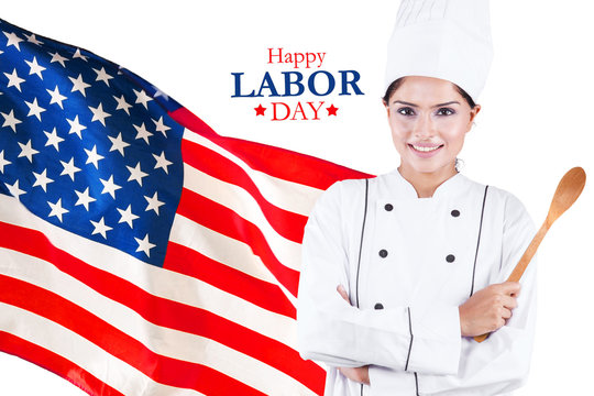 Confident chef stands with Happy Labor Day text