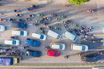 Top down view of cars and motorcycle at rush hour