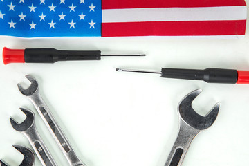 Wrenches and screwdriver with American flag