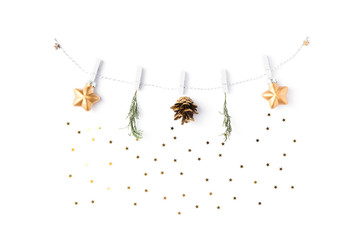 Christmas background. Garland made of gold balls and fir tree branches isolated on white background. Winter and 2020 new year concept. Flat lay, top view