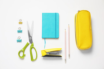 Composition with scissors and school stationery on white background, top view