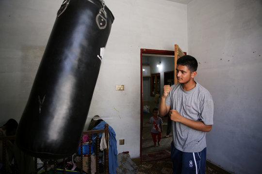 Muhammad Aimal Farzan, 16,  practices kickboxing at his home in Manak Payan refugee camp in Muzaffarabad