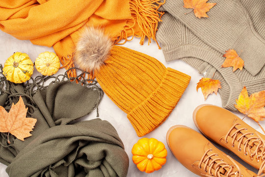 Flat lay with comfort warm outfit for cold weather. Comfortable autumn, winter clothes shopping, sale, style in trendy colors idea