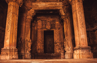 Carvings and reliefs inside sacred Hindu temple in Khajuraho, India. Artworks, columns and altar in the 10th century indian temple