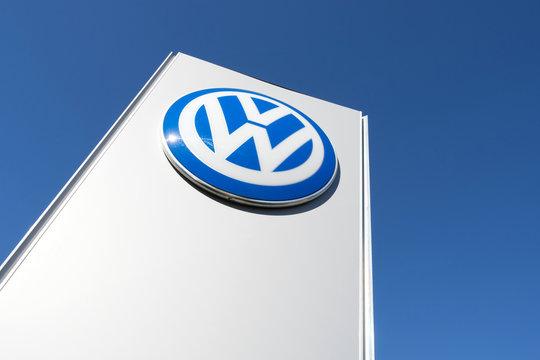 NOORDWIJK, THE NETHERLANDS - JUNE 29, 2019: Volkswagen dealership sign against blue sky. Volkswagen is a German automaker founded on 28 May 1937 and headquartered in Wolfsburg.