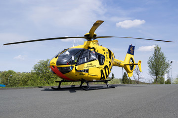 SIEGEN, GERMANY - April 22, 2018: ADAC Luftrettung rescue helicopter D-HDEC of type Eurocopter EC-135 P2.
