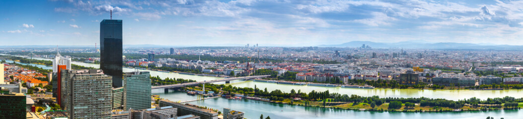 Wall Murals Vienna Stunning aerial panoramic cityscape view austrian capital city of Vienna. Modern glass-concrete skyscrapers in the ancient city on the banks the Danube -of the largest river in Europe. Hot summer day