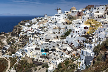 Panoramic view from Oia village with windmill on Santorini island, Greece.
