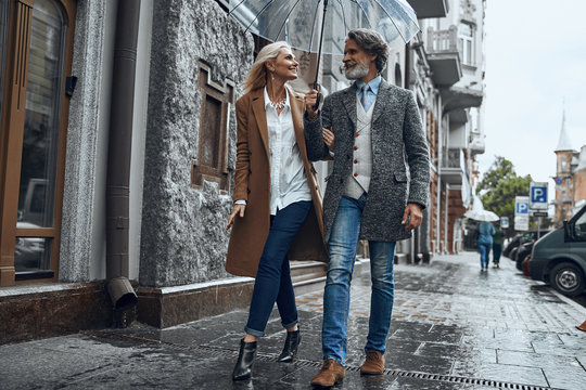 Romantic walk in the rain stock photo