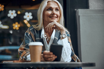 Elegant smiling lady with smartphone stock photo