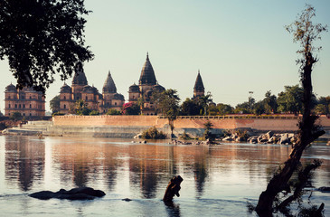 Riverside in indian town Orchha with historical buildings and beautiful landscape. India, state Madhya Pradesh