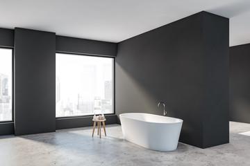 Spacious gray bathroom corner with tub
