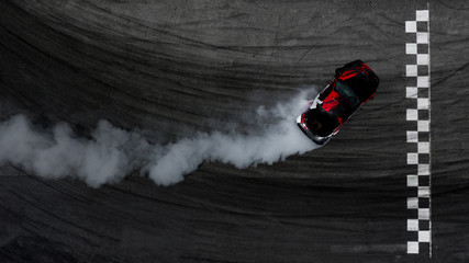 Aerial top view car drifting on race track with finish line and lots of smoke from burning tires. Fototapete