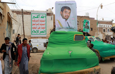 A car with a picture of Ibrahim Badreddin al-Houthi, brother of the Houthi movement leader, is seen during his funeral in Saada