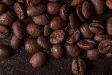 Coffee beans  on stone background. Top view with copy space for your text. Roasted coffee beans background. Beans texture, macro
