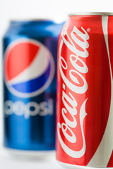 Cans of Pepsi and Coca-Cola. They are among the most popular carbonated drinks in the world.