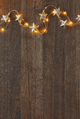 Christmas wooden background with festive decorative garland