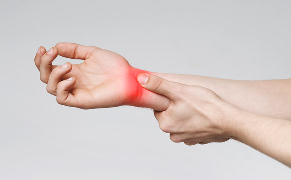Young man suffering from carpal tunnel syndrome