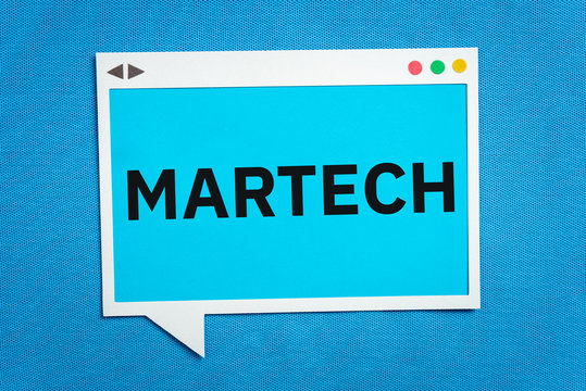MARTECH written on a speech bubble on blue background. Martech is the blending of marketing and technology.