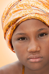 Close-up portrait of a young Afro beauty wearing a turban (12 years old)